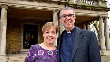 Jo and Simon Harvey pictured outside St Mary's Islington after his last service as vicar on 06.01.1