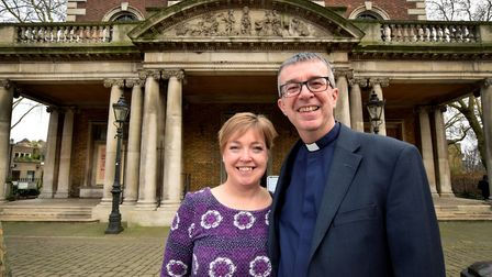 Jo and Simon Harvey pictured outside St Mary's Islington after his last service as vicar on 06.01.19