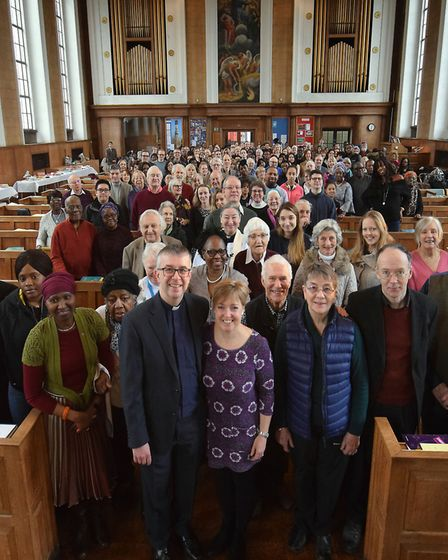 Rev Simon Harvey and his wife Jo, together with the whole congregation after his last service as vic