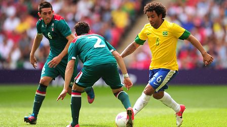Brazil's Marcelo in action with Mexico's Israel Sabdi Jimenez Nanez (centre) and Hector Herrera Rubi