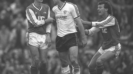 Arsenal's Graham Rix (right) steps in to pull team-mate Nigel Winterburn away from a confrontation w