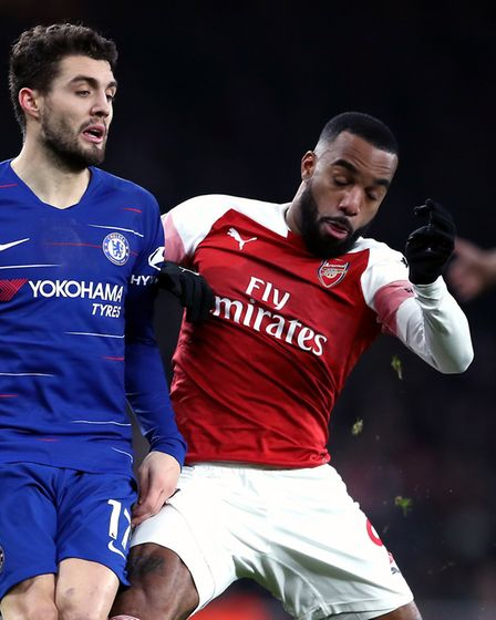 Chelsea's Mateo Kovacic (left) and Arsenal's Alexandre Lacazette (right) battle for the ball. PA
