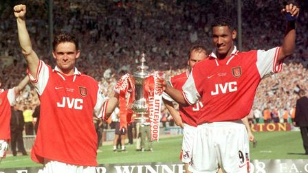 Arsenal goal-scorers Marc Overmars (left) and Nicolas Anelka celebrate with the cup after victory ov