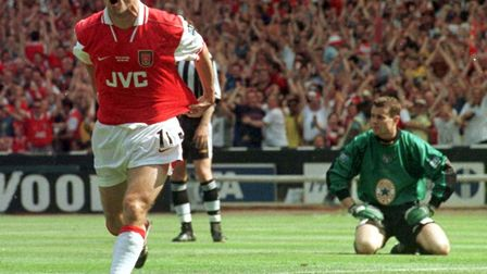 Arsenal's Marc Overmars celebrates after scoring past Newcastle keeper Shay Given during the 1998 FA