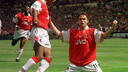 Nicolas Anelka rushes to congratulate Marc Overmars after scoring the first goal for Arsenal early i