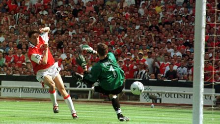 Arsenal's Marc Overmars scores Arsenal's first goal to give them a 1-0 lead during the 1998 FA Cup F