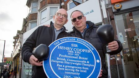 Henry Cooper's sons John and Henry unveil the blue plaque at the site of their father's old shop in