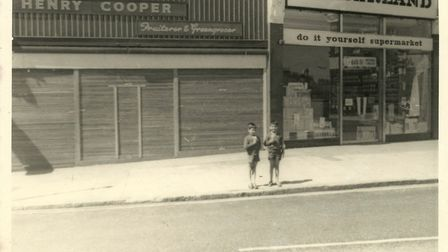 L-R Tony Royden and his brother Laurence outside Henry Cooper's grocey shop in Wembley. Picture: Ton