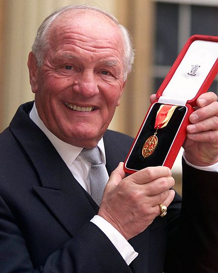 Former British heavyweight boxing champion Sir Henry Cooper after receiving a knighthood at an inves