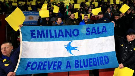 Cardiff City fans in the stands with a flag reading 'Emiliano Sala Forever a Bluebird' during the Pr