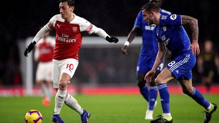 Arsenal's Mesut Ozil and Cardiff City's Joe Ralls during the Premier League match at the Emirates St