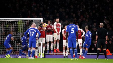The Arsenal wall attempt to block the free kick from Cardiff City's Joe Bennett during the Premier L