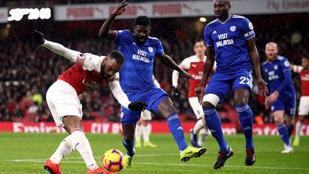 Arsenal's Alexandre Lacazette has a shot challenged by Cardiff City's Bruno Ecuele Manga during the