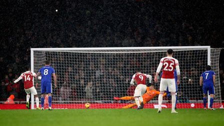 Arsenal's Pierre-Emerick Aubameyang scores from the penalty spot during the Premier League match at