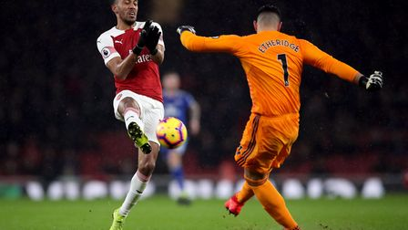 Arsenal's Pierre-Emerick Aubameyang attempts to block the ball as Cardiff City goalkeeper Neil Ether