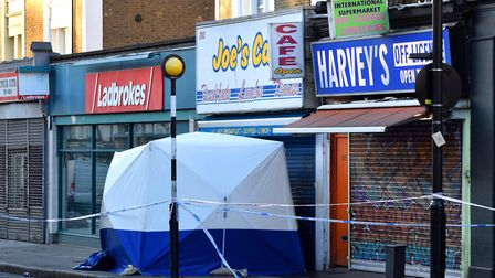 A police tent in the Caledonian Road on Wednesday morning. Picture: Polly Hancock