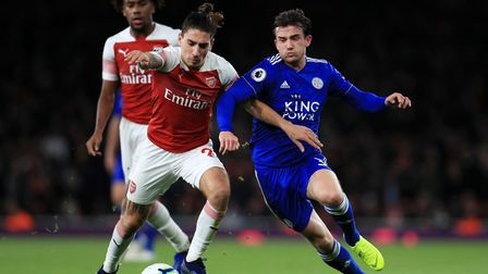 Arsenal's Hector Bellerin and Leicester City's Ben Chilwell battle for the ball during the Premier L