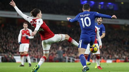 Arsenal's Hector Bellerin fouls Chelsea's Eden Hazard leading to a penalty (pic Adam Davy/PA)