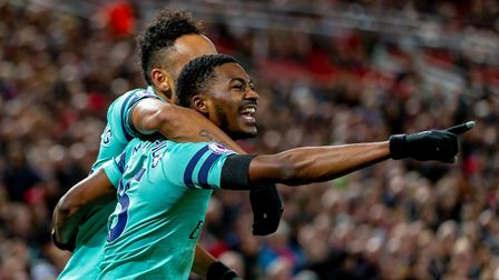 Ainsley Maitland-Niles of Arsenal celebrates scoring in the Premier League game between Liverpool v
