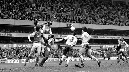 Tottenham Hotspur goalkeeper Ray Clemence (second l) punches clear from Arsenal's Niall Quinn (l), V