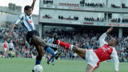 Ian Wright of Arsenal (right) and Viv Anderson of Sheffield Wednesday challenge for the ball at High