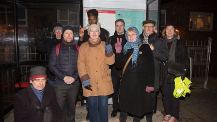 Residents vigil at a bus stop with Nazi slogan, Peters Avenue. Picture: Jonathan Goldberg