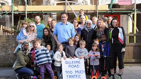 Paul Kirk, pictured centre in a blue shirt, has led a campaign for Islington Council to close the Gi