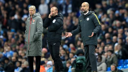 Manchester City manager Pep Guardiola (right) and Arsenal manager Arsene Wenger (left) on the touchl