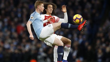 Manchester City's Kevin De Bruyne (left) and Arsenal's Matteo Guendouzi battle for the ball during t