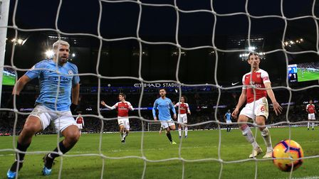 Manchester City's Sergio Aguero scores his side's second goal. PA