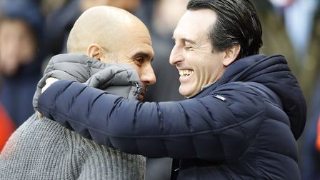 Manchester City manager Pep Guardiola (left) and Arsenal manager Unai Emery greet each other before