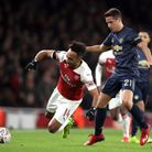 Arsenal's Pierre-Emerick Aubameyang (left) and Manchester United's Ander Herrera battle for the ball