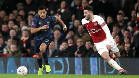 Manchester United's Alexis Sanchez (left) and Arsenal's Sead Kolasinac battle for the ball (pic John