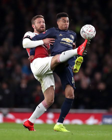 Arsenal's Shkodran Mustafi (left) and Manchester United's Jesse Lingard battle for the ball (pic Joh