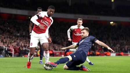 Arsenal's Ainsley Maitland-Niles (left) and Manchester United's Luke Shaw battle for the ball (pic J