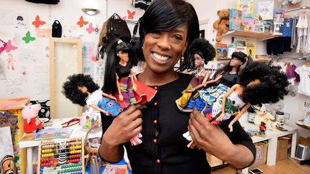 Sandra Monero with the dolls she designs and dresses at her Balls Pond Road shop. Picture: Polly Han