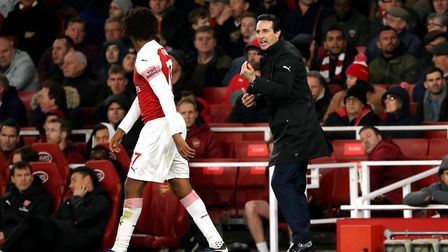Arsenal manager Unai Emery and Alex Iwobi during the Premier League match at the Emirates Stadium, L