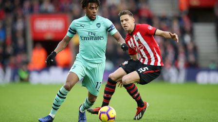 Arsenal's Alex Iwobi (left) and Southampton's Jan Bednarek battle for the ball during the Premier Le