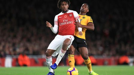 Arsenal's Alex Iwobi (left) and Wolverhampton Wanderers' Ivan Cavaleiro battle for the ball during t