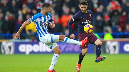 Huddersfield Town's Tommy Smith (left) and Arsenal's Sead Kolasinac battle for the ball during the P