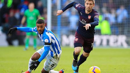 Huddersfield Town's Elias Kachunga (left) and Arsenal's Nacho Monreal battle for the ball during the