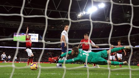 Manchester United goalkeeper David de Gea makes a save from Tottenham Hotspur's Dele Alli during the