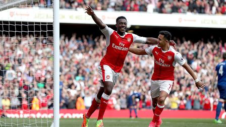 Arsenal's Danny Welbeck (left) celebrates scoring his side's second goal against Manchester United w