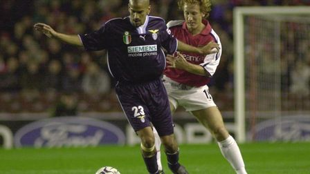 Arsenals Ray Parlour (right) battles with Lazios Juan Veron in the Champions League Group B match at