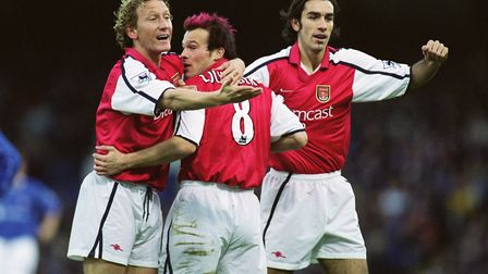 Arsenal players Ray Parlour (left) and Robert Pires (right) congratulate Fredrik Ljungberg (centre)