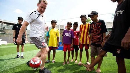 The legendary Ray Parlour with youngsters in Indonesia helped by the Arsenal Foundation. CREDIT ARSE