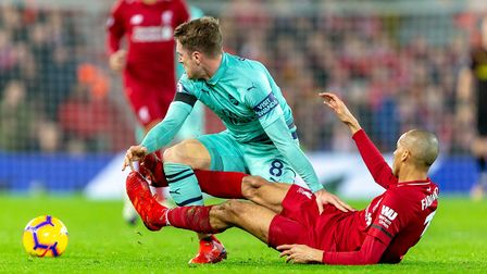 Aaron Ramsey of Arsenal is fouled by Fabinho of Liverpool in the Premier League game between Liverpo