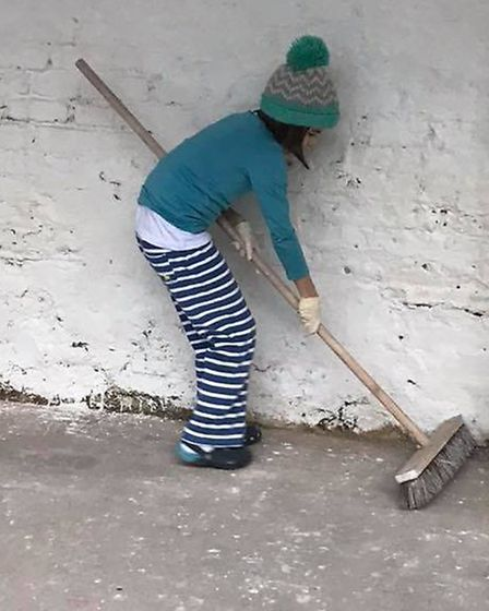 The community comes together to clean create the new Solidarity Centre. Picture: Jon Glackin