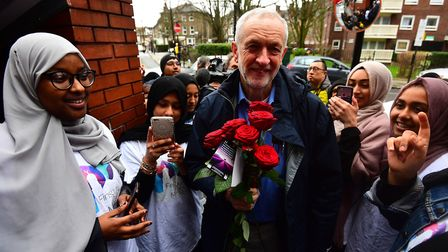 Labour Party leader Jeremy Corbyn is presented with some flowers as he arrives at the Finsbury Park