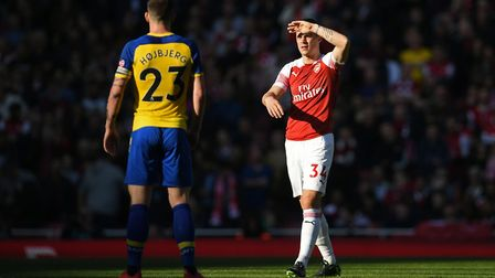 Arsenal's Granit Xhaka shields his eyes from the sun during the Premier League match at the Emirates